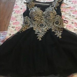 Black and gold dress with Rhinestone.
